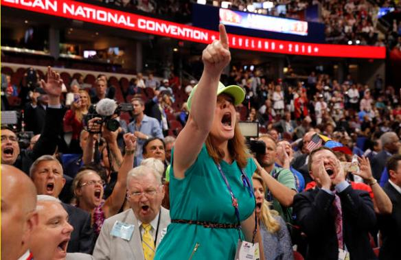 An opponent of the Republican National Convention Rules Committee's report and rules changes screams at the Republican National Convention in Cleveland